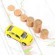 Toy car and coins on financial graph — Stock Photo