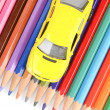 Color pencils and toy car — Stock Photo #12144864