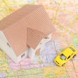 Toy car and house model on map — Stock Photo #12145588