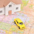 Toy car and house model on map — Stock Photo #12145670