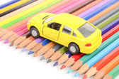 Color pencils and toy car — Stok fotoğraf