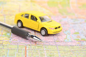 Toy car and map with pen — Stock Photo