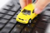 Dart board and toy car — Stock Photo