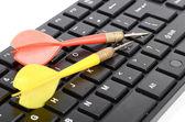 Darts and keyboard — Stock Photo