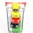 Shopping cart and toy car - Stock Photo