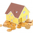 Model house and coins — Stock Photo