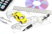 Toy car and blueprint — Stock Photo