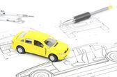 Toy car on blueprint — Stock Photo