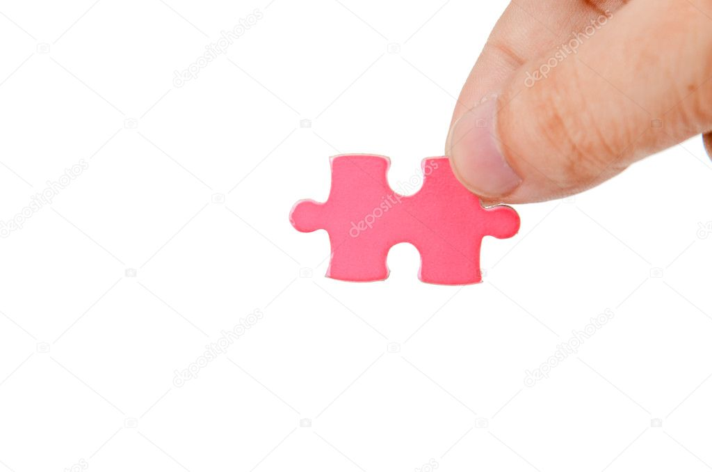 Puzzle in hand on white background — Stock Photo #12190720