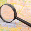 Stock Photo: Map and magnifier