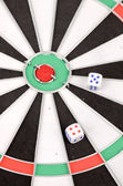 Dices and dartboard — Stock Photo