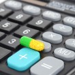 Medicine and calculator — Stock Photo #12243987