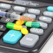 Medicine and calculator — Stock Photo #12244028