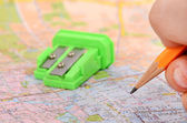 Pencil and sharpener on map — Stock Photo