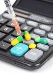 Medicine and calculator — Stock Photo