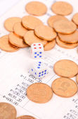 Coins and bank book with dices — Stock Photo