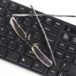 Stock Photo: Computer keyboard and eye glasses