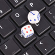 Keyboard and dices — Stock Photo