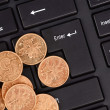 Stock Photo: Keyboard and coins