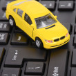 Toy car on keyboard — Stock Photo