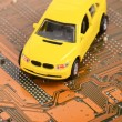 Toy car and circuit board — Stock Photo