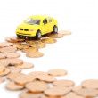 Toy car and coins — Foto Stock