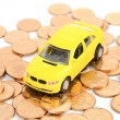 Toy car and coins — Stockfoto