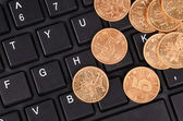 Keyboard and coins — Stock Photo