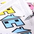 Receipts and house with pen - Stock Photo