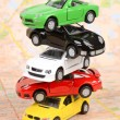 Toy cars on map — Stock fotografie
