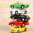 Toy cars on map — Stockfoto #12297789