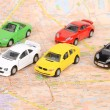 Toy cars on map — Stockfoto