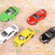 Toy cars on map — Foto de stock #12297889