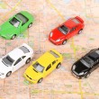 Toy cars on map — Stock Photo