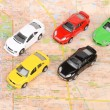 Toy cars on map — Stockfoto #12297945