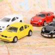 Foto Stock: Toy cars on map