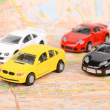 Toy cars on map — Stockfoto #12297977
