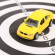 Stock Photo: Toy car on dart board