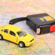 Toy car and steel tape on map - Stock Photo