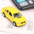 Royalty-Free Stock Photo: Toy car and calculator