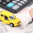 Toy car and calculator — Stock Photo