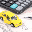 Toy car and calculator — Stock Photo #12302053
