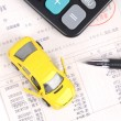 Toy car and calculator — Stock Photo #12302093