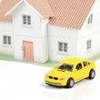 Toy car and house on white background — Stock Photo