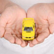 Toy car in hand — Stock Photo
