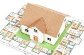 Model house and blueprint — Stock Photo