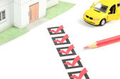 Check box and car with house — Stock Photo