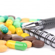 Medicine and notepad with pen — Stok fotoğraf
