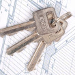 Stock Photo: Key and house plan
