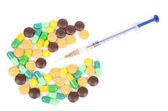 Medicine and syringe on white background — Stock Photo